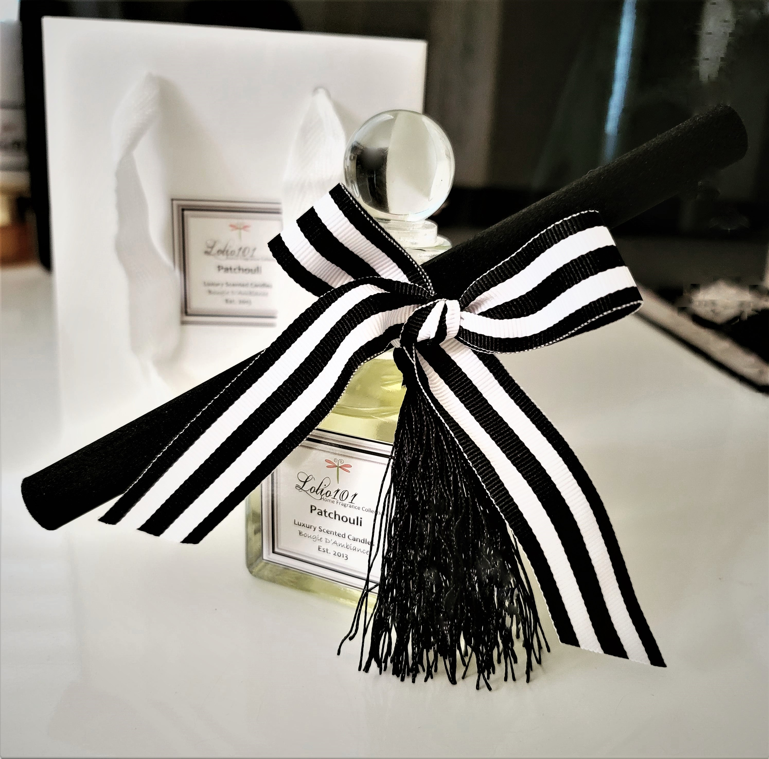lolio101 reed diffuser glass ball closure glass bottle patchouli white bag black and white stripped