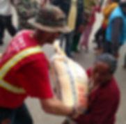 Volunteer Giving Rice to the Needy