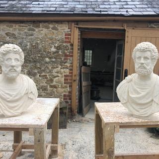 Antoninus Pius and Marcus Aurelius outside the carving workshop.
