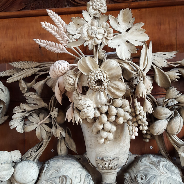 Grinling Gibbons Alterpiece central section showing the limewood replacement carvings. Trinity Chapel Oxford.