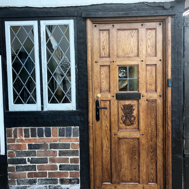 Made to measure solid Oak door with wheatsheaf carving.