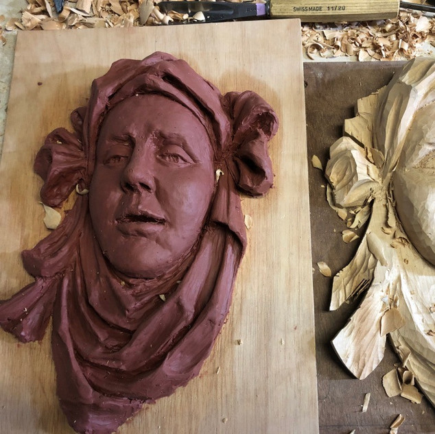 Terracotta wax maquette and the beging of the carving.