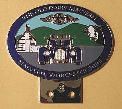 The Old Dairy Malvern chrome badge