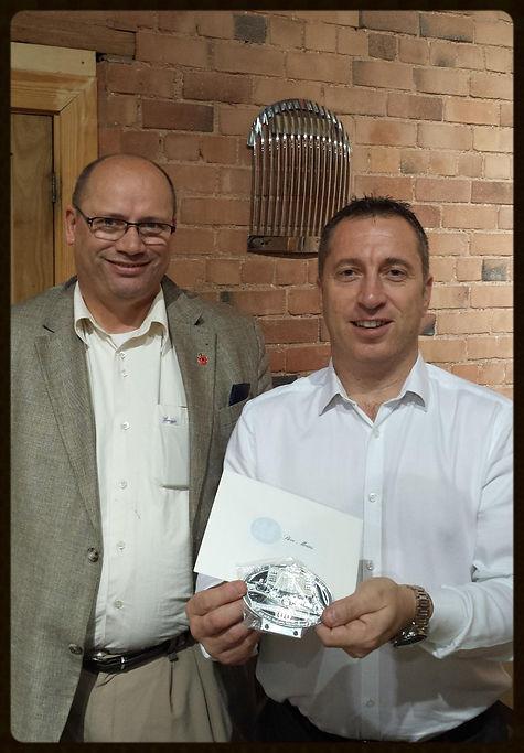 Morgan CEO Steve Morris receives the badge from Morgancarbadges.com owner Hermen Pol