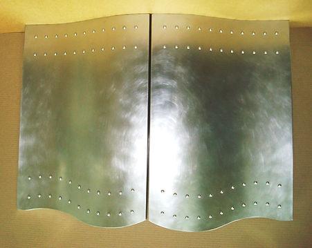 Гнутый фасад из нержавеющей стали
