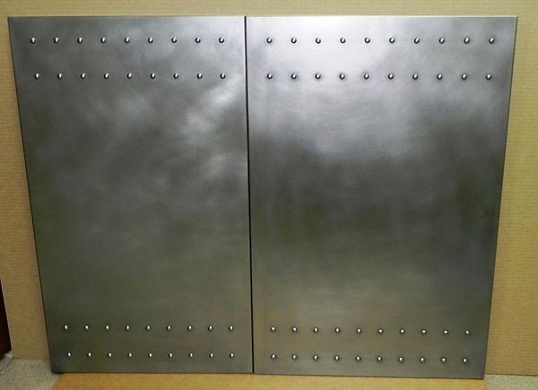фасады с заклепками из нержавеющей стали