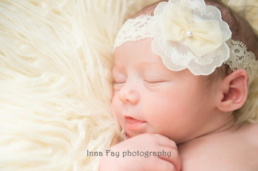 Sweet baby girl on her newborn photo session