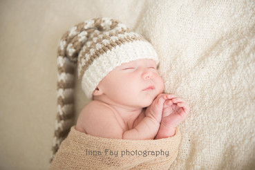 Newborn baby boy at his first photo shot