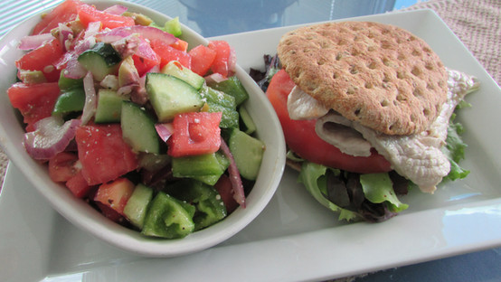 Pork Cutlet on a Bun side Greek Salad