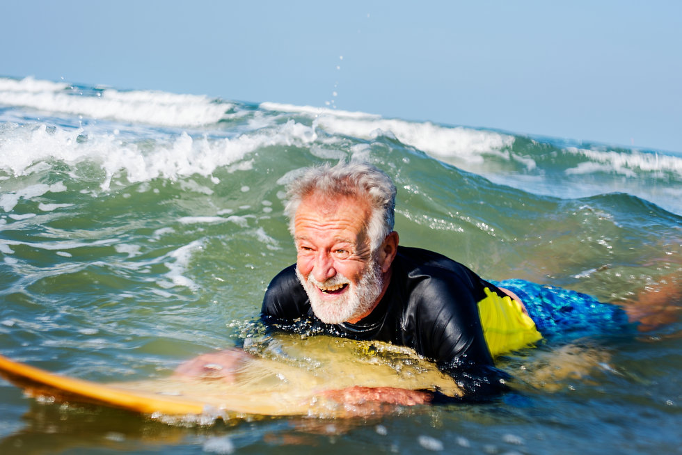Mature surfer ready to catch a wave.jpg