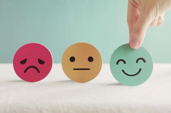 Hand choosing happy smile face paper cut