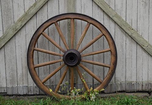 Refurbished wood and steel wagon wheel.