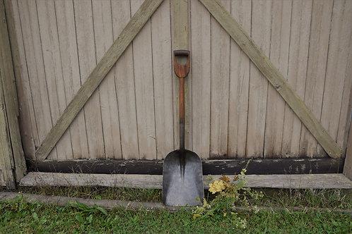 Refurbished wood and steel coal shovel.