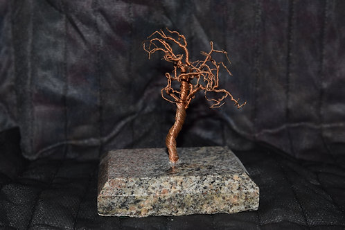 Wire tree on polished granite base.