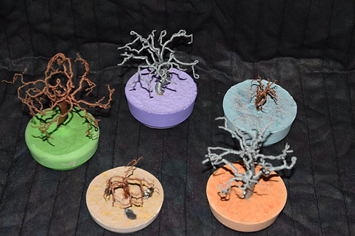 Wire trees on colorful plaster bases.