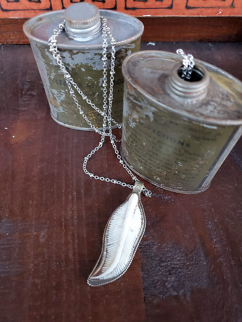 LEFT FEATHER PENDULUM