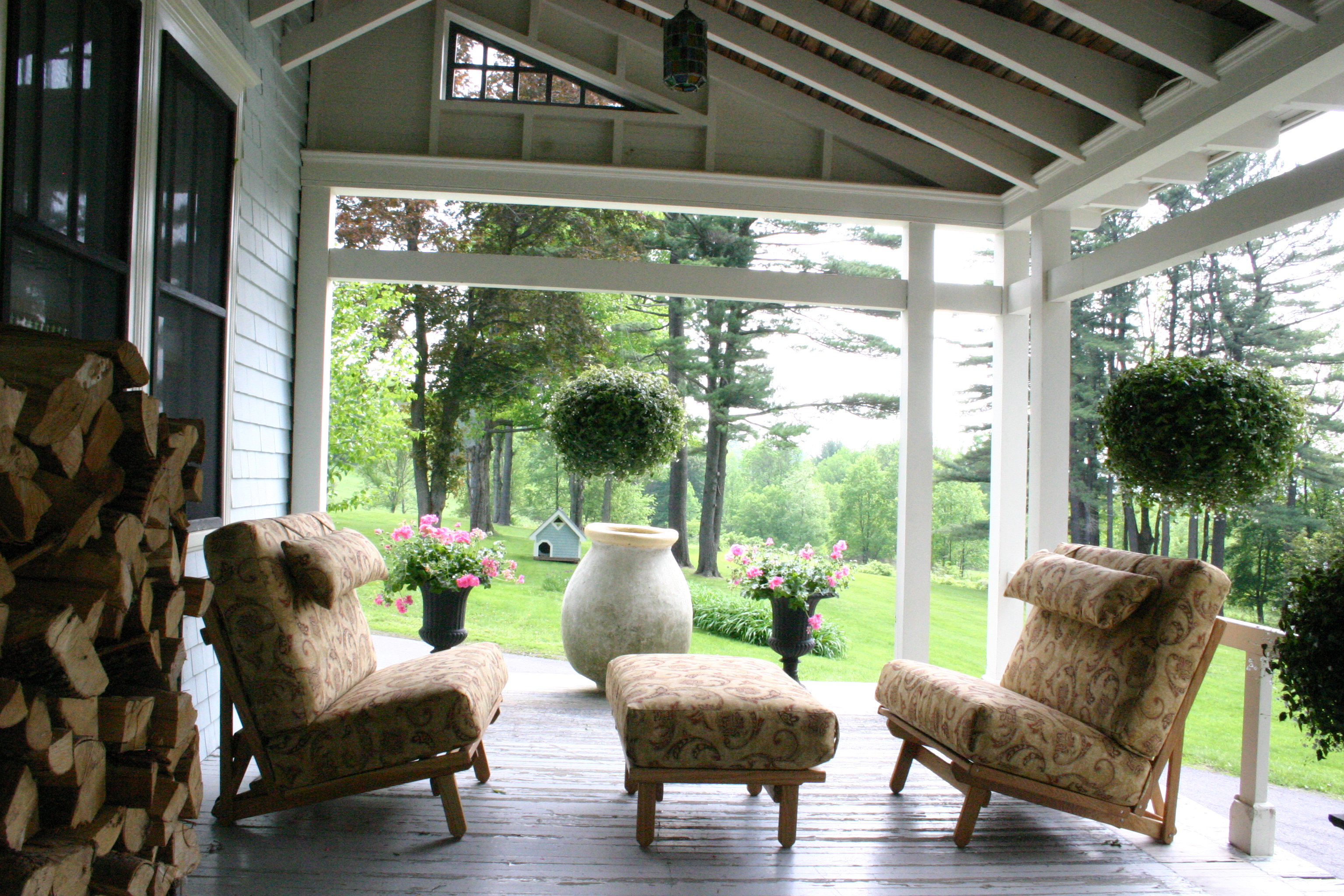 Twin Chairs with Ottomans on Porch