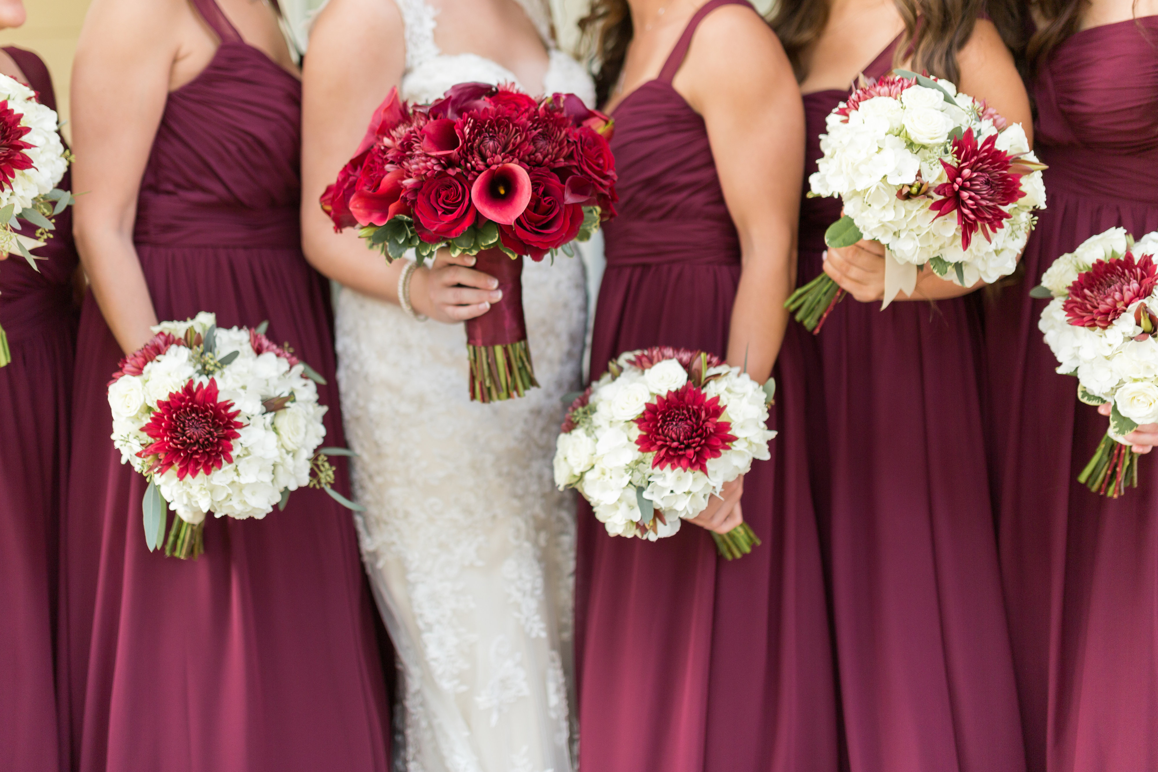 Red Bridesmaid Dresses With White Bouquets