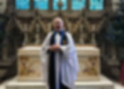 Mike picture in front of altar.jpg
