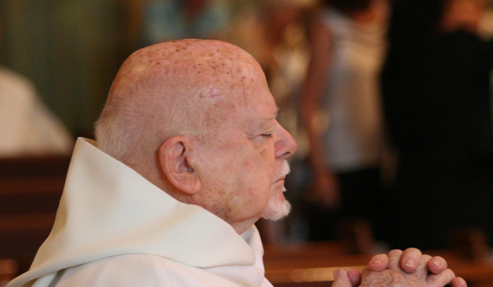 06 Fr. Buckley Deep in Prayer.jpg