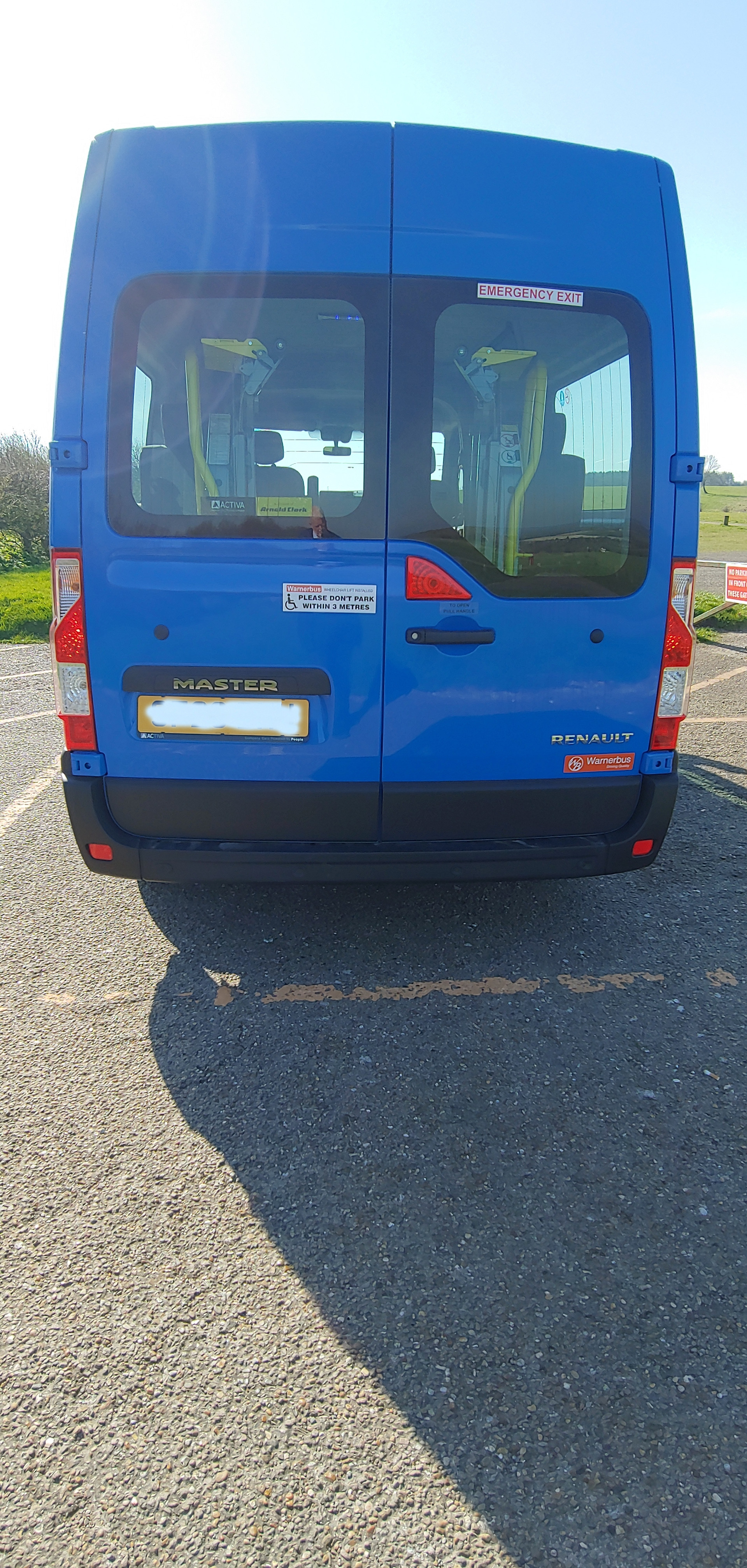 Rear view of Warnerbus converted Renault Master