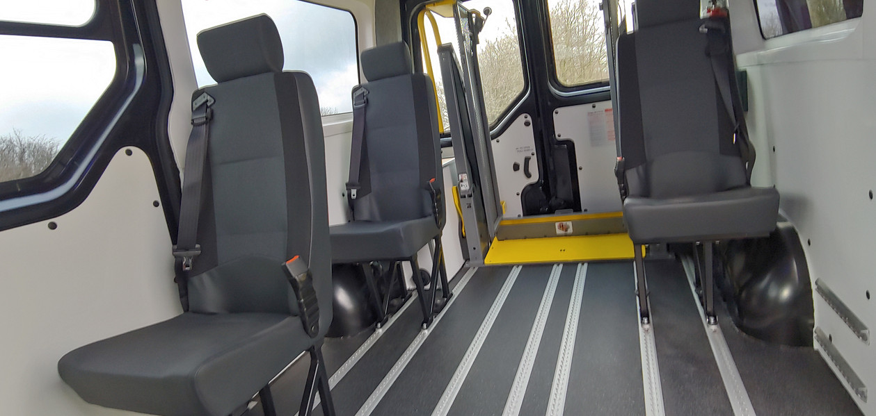 Seating with wipe down cushions fitted in Warnerbus conversion