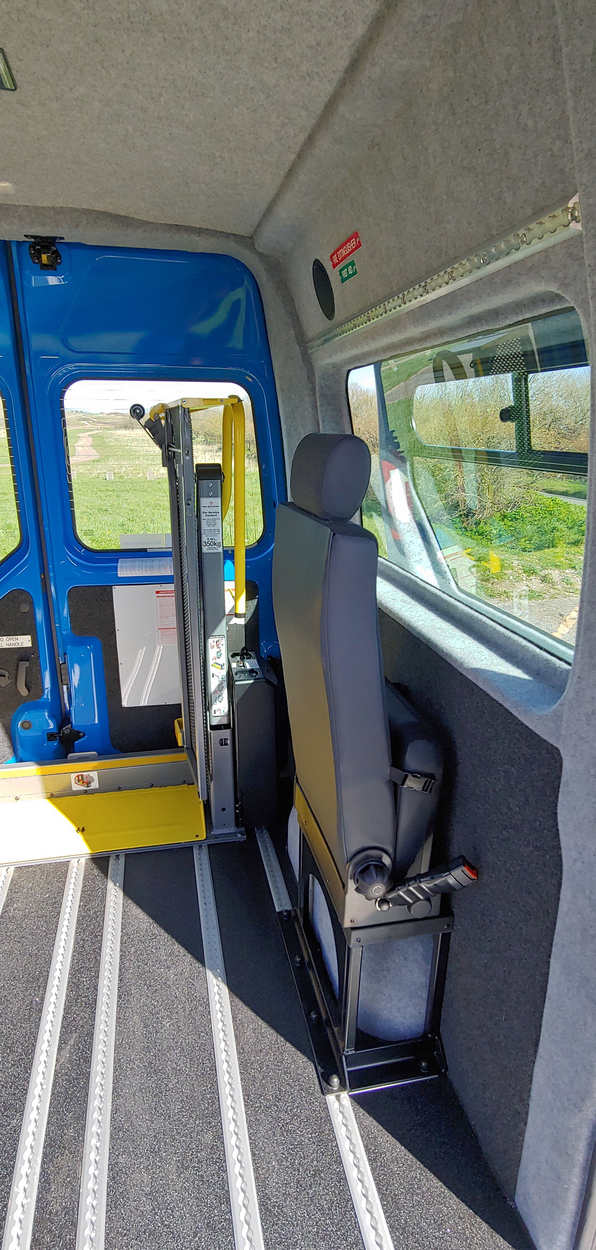 Folded seat in Warnerbus converted minibus