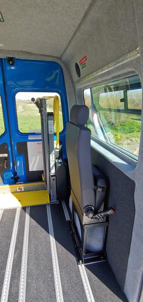 Folded seat in Warnerbus converted minibus