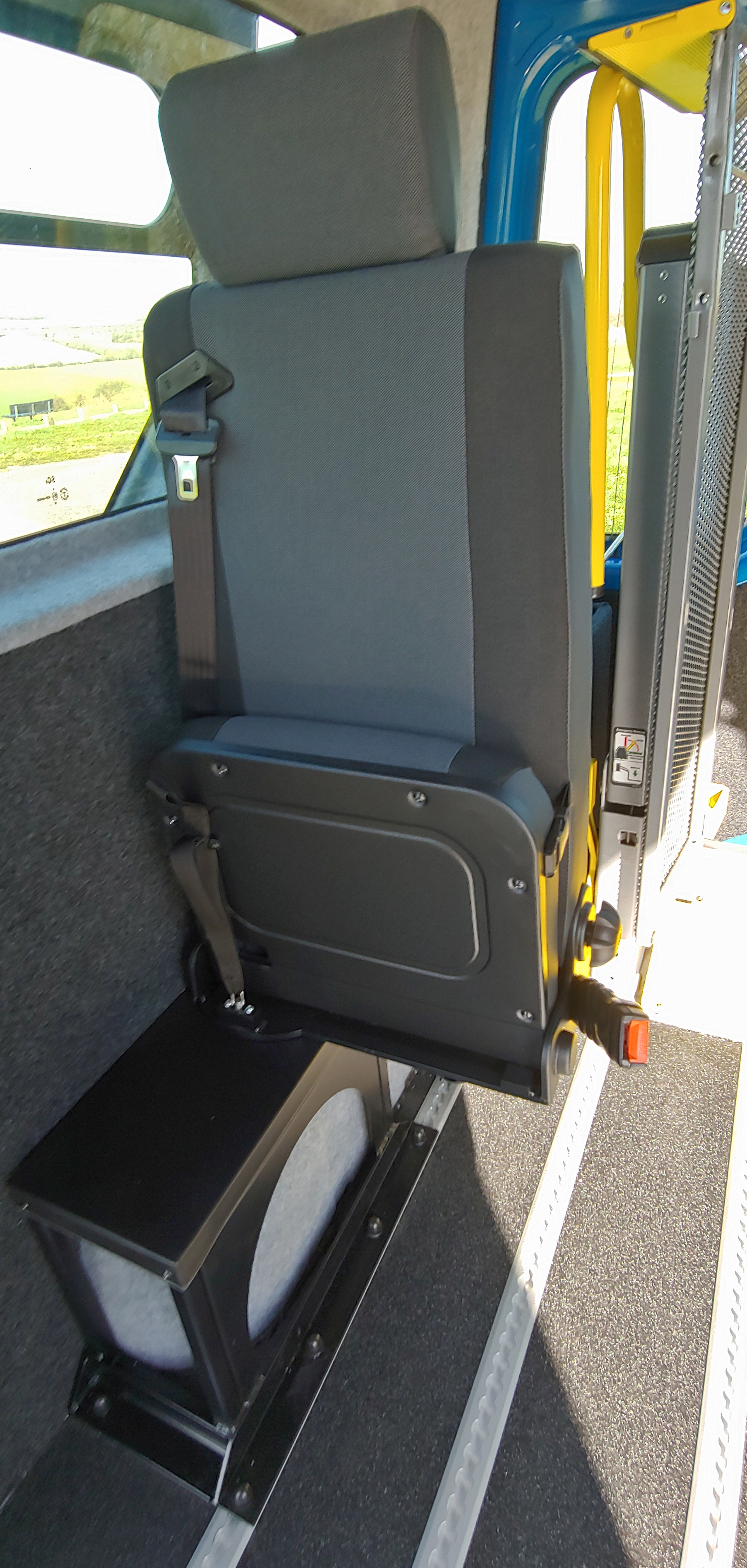 Seat folded up offside in Warnerbus converted Renault Master