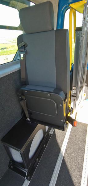 Seat folded up offside in Warnerbus converted Renault Master