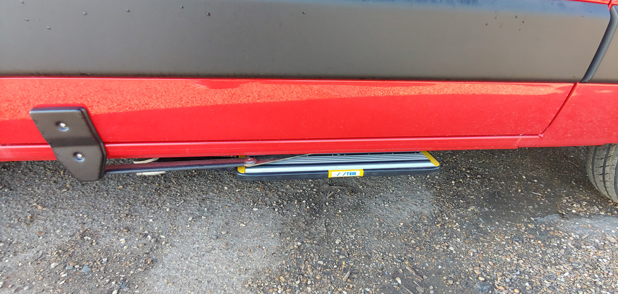 Door operated side step
