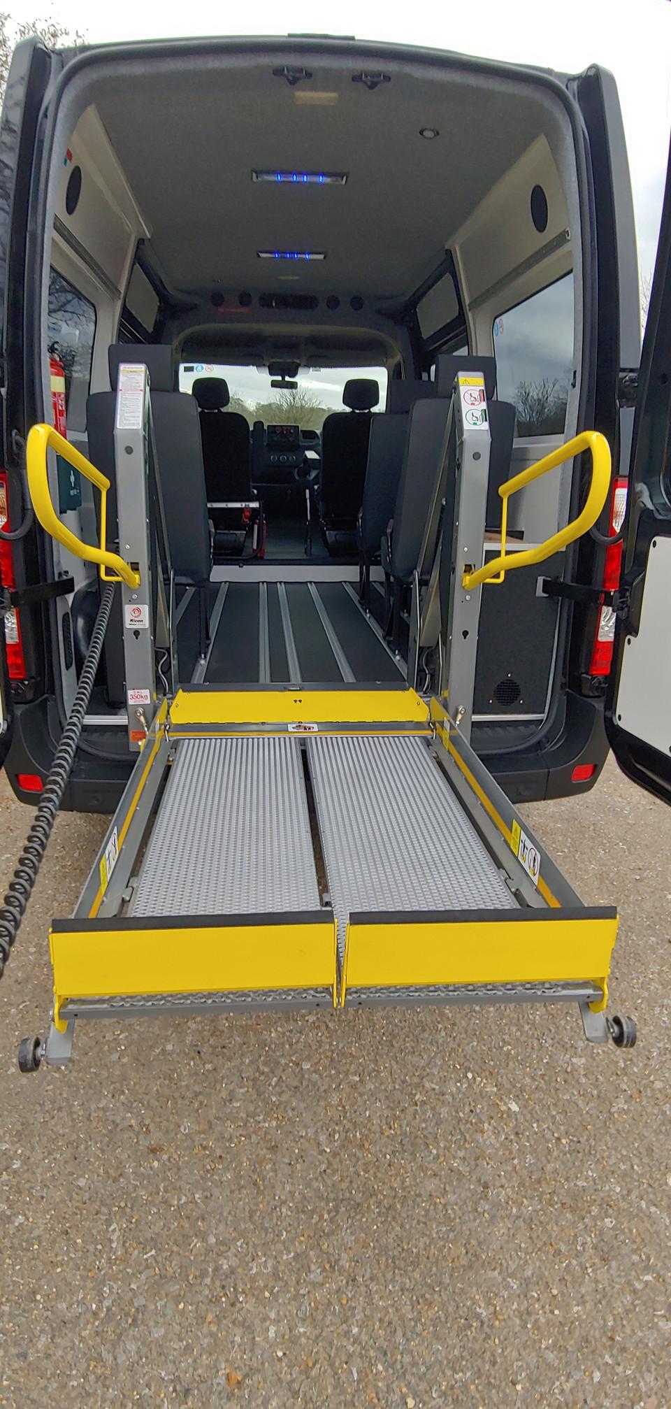 Tail lift deploying in Warnerbus conversion