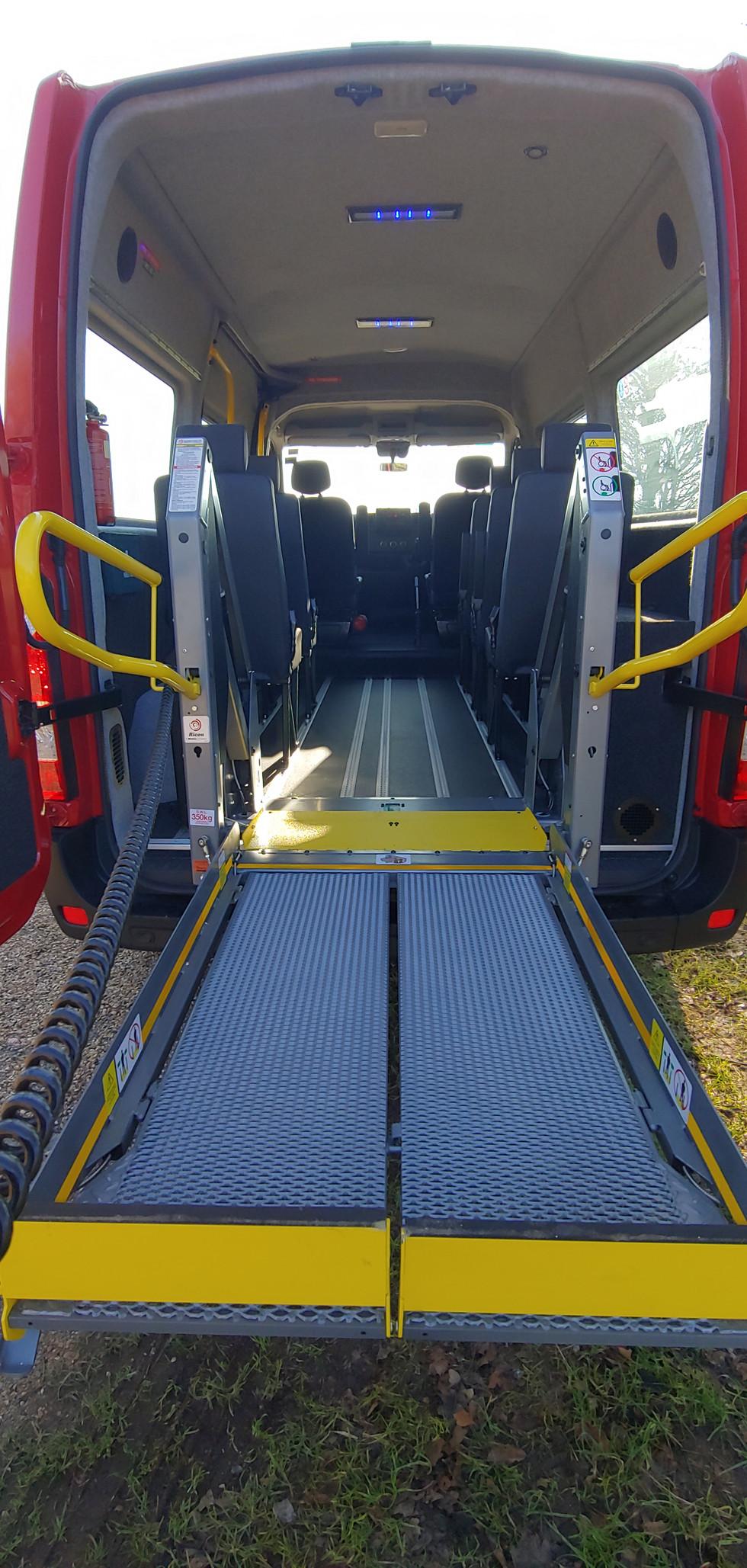 Half deployed tail lift Warnerbus minibus
