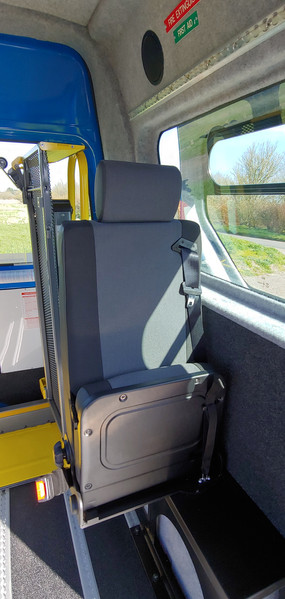 Seat folded up in Warnerbus conversion