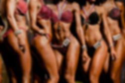 A group of fitness show women with bikinis.