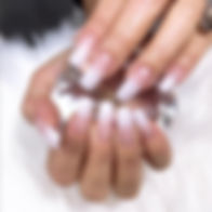 Woman holding gem showing acrylc nails, ombre nails. Ottawa's top nail bar.