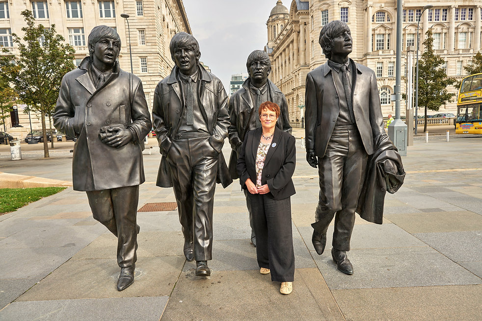 Julie Kershaw Blue Badge Tour Guide of Liverpool with Beatles statue