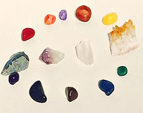 Image of various colored crystals and polished gemstones