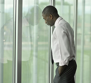 Image of African American businessman symbolizing the feeling of depression