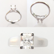 Emerald cut diamond ring.png