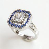 Platinum diamond and sapphire ring.png