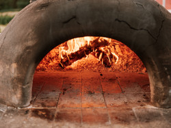 pizza oven with fire by Stolen Glimpses.