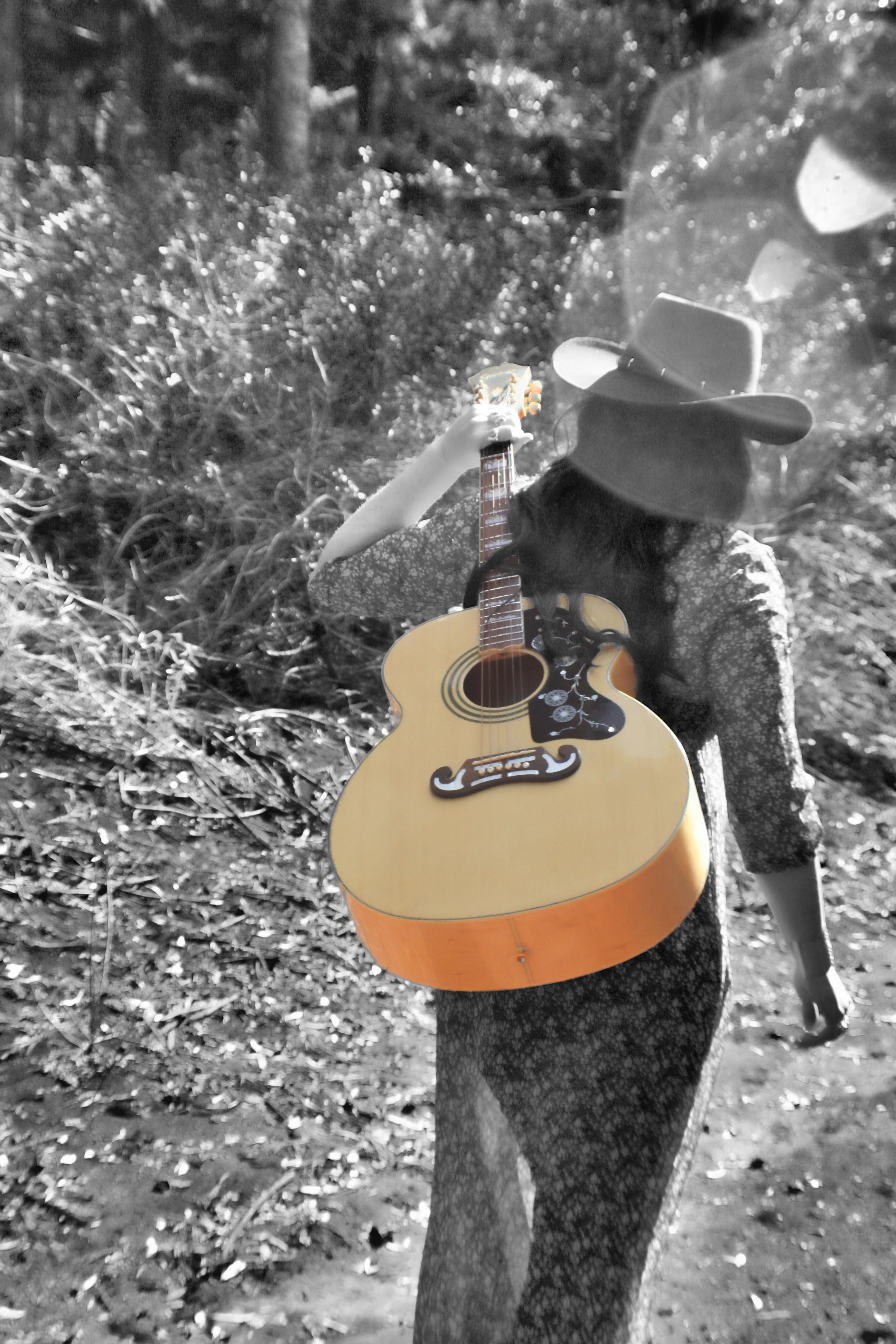 walking_away_with_Guitar_BnW