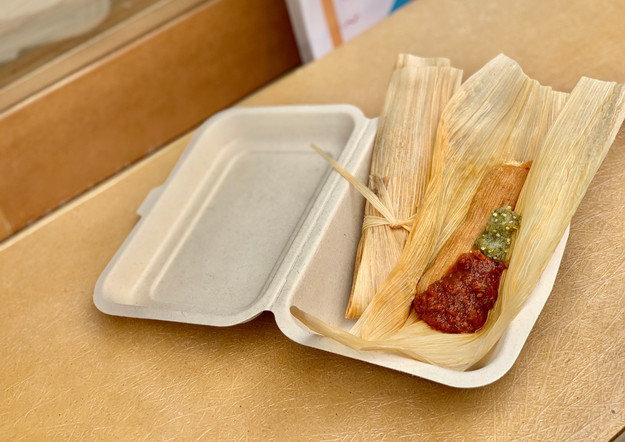Tamales with salsa roja and salsa verde
