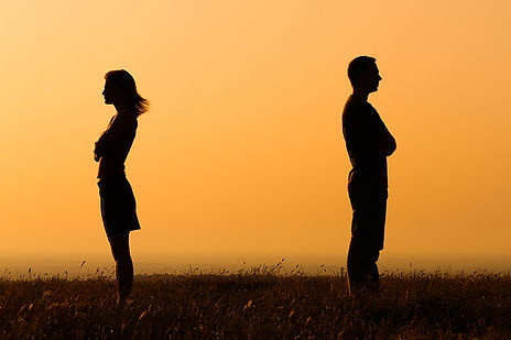 man and woman silhoutte standing apart, why women initiate divorce, why women divorce, reasons women divorce,  women and unhappy marriage