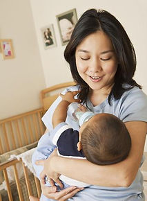 Singapore Confinement nanny services loving mother carrying sleeping baby