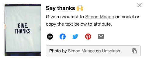 Example from Unsplash of pop up encouraging attribution with links and text to copy.