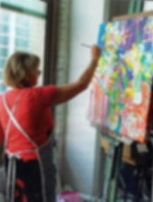 Florida Artist Tara Funk Grim working on a painting in her Forida Studio