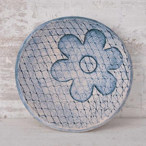 small round ceramic dish