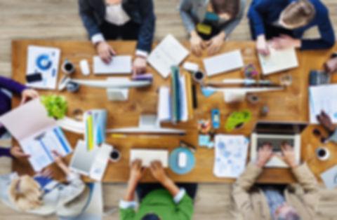 Group of people around a desk meeting.jpg